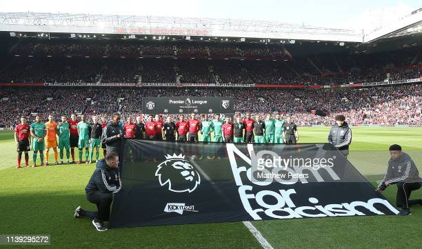 The two teams line up behind a No Room For Racism banner ahead of the Premier League match between Manchester United and Watford FC at Old Trafford...