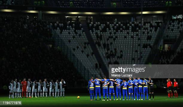 The two teams line up for a minute's silence in memory of Pietro Anastasi before the Serie A match between Juventus and Parma Calcio at Allianz...