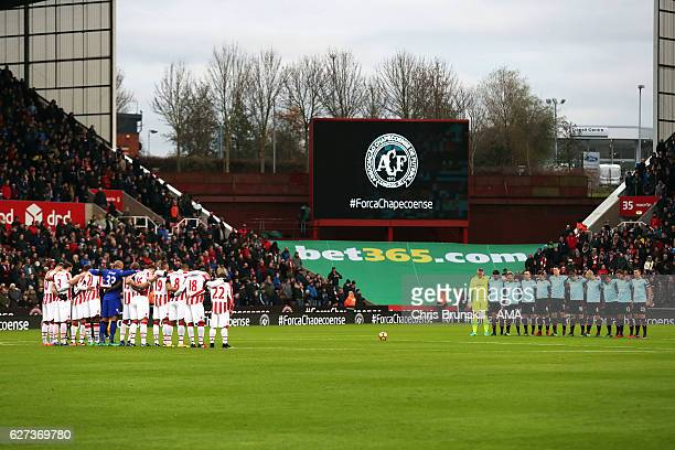 The two teams line up for a minute's silence in memory of the Chapecoense football club ahead of the Barclays Premier League match between Stoke City...