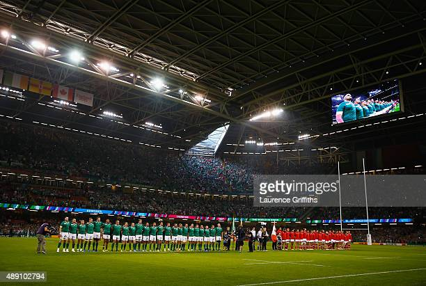 The two teams line up for the national anthems ahead of the 2015 Rugby World Cup Pool D match between Ireland and Canada at the Millennium Stadium on...