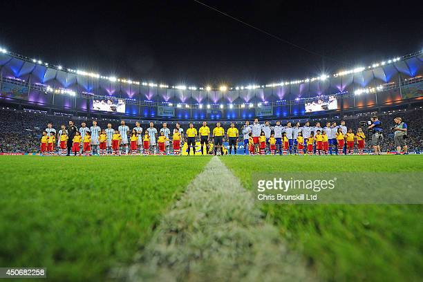The two teams line up for the national anthems before of the 2014 FIFA World Cup Brazil Group F match between Argentina and BosniaHerzegovina at...