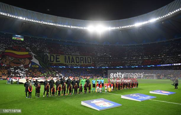 The two teams line up prior to the UEFA Champions League round of 16 first leg match between Atletico Madrid and Liverpool FC at Wanda Metropolitano...
