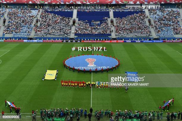 The two teams line up to listen to their national anthems at the start of the 2017 Confederations Cup group A football match between Russia and New...