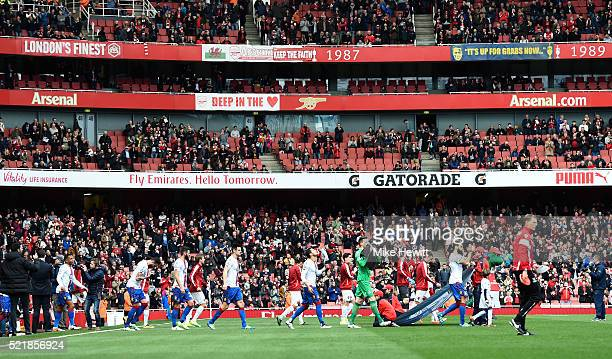 The two teams make their way on to the pitch ahead of the Barclays Premier League match between Arsenal and Crystal Palace at the Emirates Stadium on...