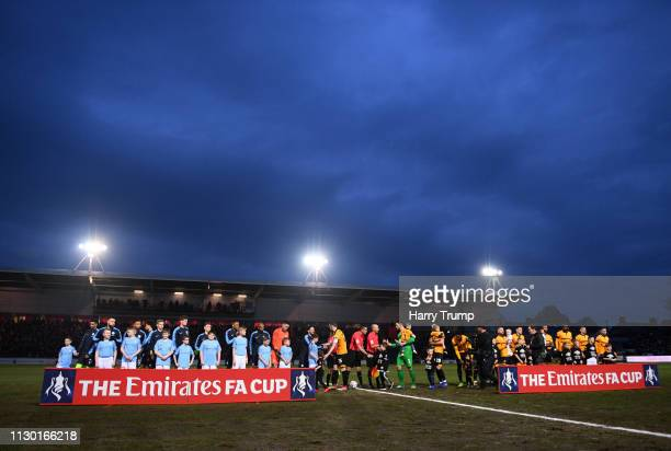 The two teams make their way out for the start during the FA Cup Fifth Round match between Newport County AFC and Manchester City at Rodney Parade on...