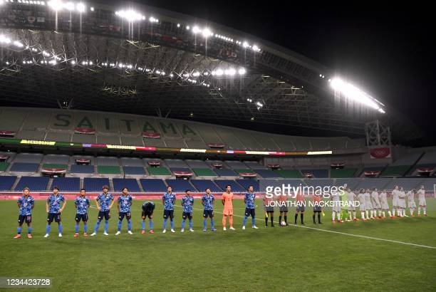 The two teams make their way to the pitch for the Tokyo 2020 Olympic Games men's semi-final football match between Japan and Spain at Saitama Stadium...