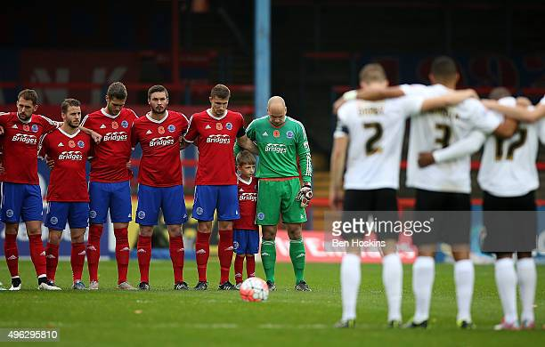The two teams observe a two minute silence ahead of The Emirates FA Cup First Round match between Aldershot Town and Bradford City on November 8 2015...