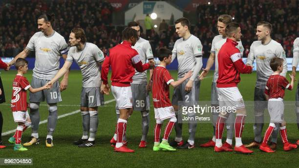 The two teams shake hands ahead of the Carabao Cup QuarterFinal match between Bristol City and Manchester United at Ashton Gate on December 20 2017...