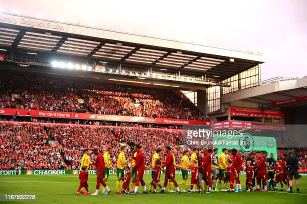 The two teams shake hands ahead of the Premier League match between Liverpool FC and Norwich City at Anfield on August 09 2019 in Liverpool United...