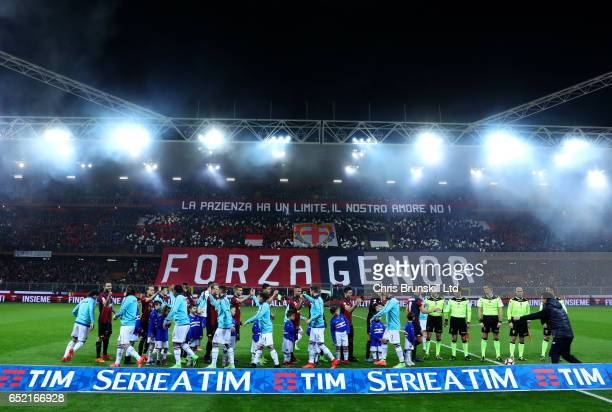 The two teams shake hands ahead of the Serie A match between Genoa CFC and UC Sampdoria at Stadio Luigi Ferraris on March 11 2017 in Genoa Italy