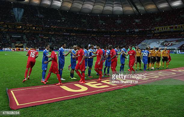 The two teams shake hands ahead of the UEFA Europa League Final match between FC Dnipro Dnipropetrovsk and FC Sevilla at the National Stadium on May...
