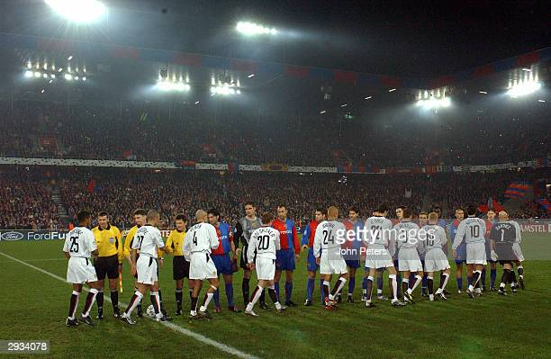 The two teams shake hands before the kick off of the UEFA Champions League Group D match between FC Basel v Manchester United at the St JakobsPark...