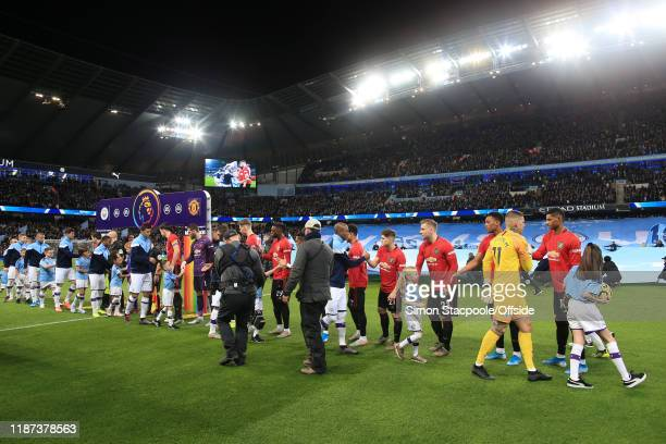 The two teams shake hands before the Premier League match between Manchester City and Manchester United at the Etihad Stadium on December 7 2019 in...