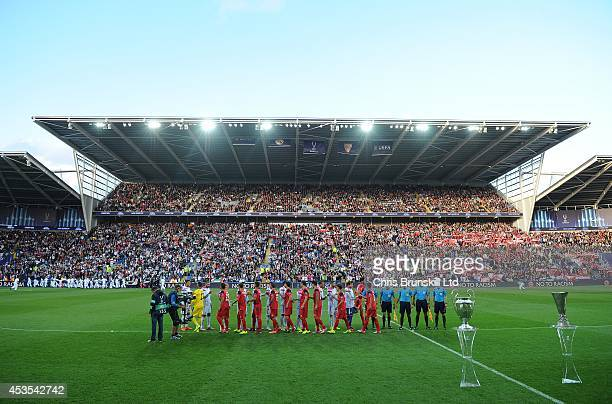The two teams shake hands prior to the UEFA Super Cup match between Real Madrid and Sevilla FC at Cardiff City Stadium on August 12 2014 in Cardiff...