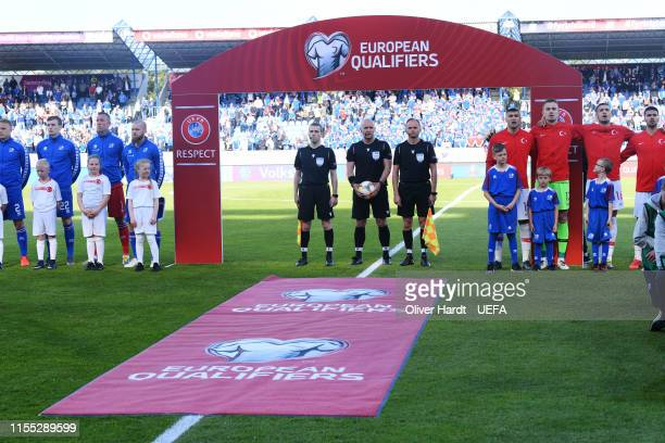 The two teams sides line up for the national anthems during the UEFA Euro 2020 Qualifier match between Iceland and Turkey at Laugardalsvollur...