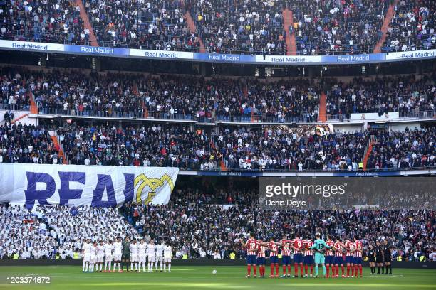 The two teams take part in a minute of silence for Kobe Bryant prior to the La Liga match between Real Madrid CF and Club Atletico de Madrid at...