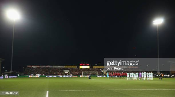 The two teams take part in a minute's applause for Jimmy Armfield ahead of the Emirates FA Cup Fourth Round match between Yeovil Town and Manchester...