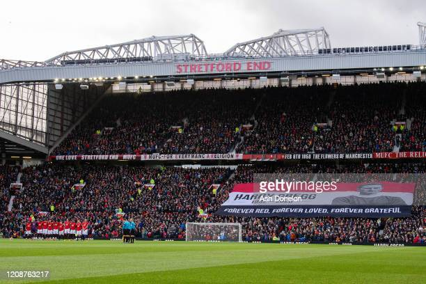The two teams take part in a minute's silence for Harry Gregg ahead of the Premier League match between Manchester United and Watford FC at Old...