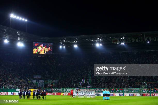 The two teams take part in a minute's silence in honour of Emiliano Sala ahead of the UEFA Europa League Round of 32 First Leg match between SK Rapid...
