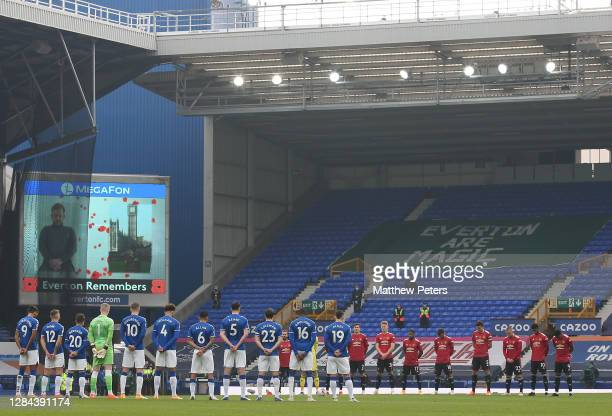 The two teams take part in a minute's silence to mark Remembrance Sunday ahead of the Premier League match between Everton and Manchester United at...