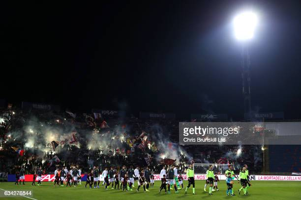 The two teams walk out ahead of the Serie A match between Bologna FC and AC Milan at Stadio Renato Dall'Ara on February 8 2017 in Bologna Italy
