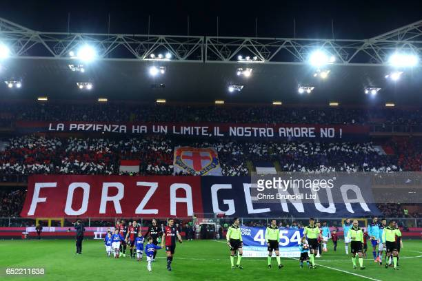 The two teams walk out ahead of the Serie A match between Genoa CFC and UC Sampdoria at Stadio Luigi Ferraris on March 11 2017 in Genoa Italy
