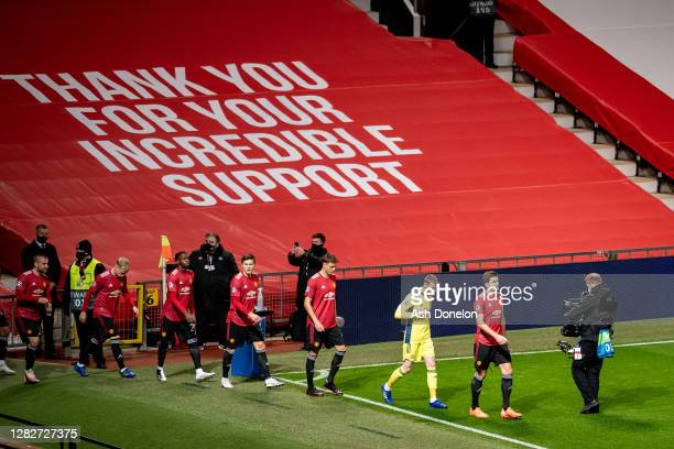 The two teams walk out ahead of the UEFA Champions League Group H stage match between Manchester United and RB Leipzig at Old Trafford on October 28...
