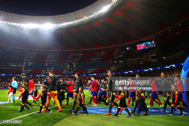 The two teams walk out ahead of the UEFA Champions League Round of 16 First Leg match between Club Atletico de Madrid and Juventus at Estadio Wanda...