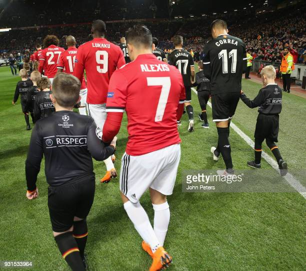 The two teams walk out ahead of the UEFA Champions League Round of 16 Second Leg match between Manchester United and Sevilla FC at Old Trafford on...