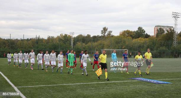 The two teams walk out ahead of the UEFA Youth League match between CSKA Moskva U19s and Manchester United U19s at Oktyabr Stadium on September 27...