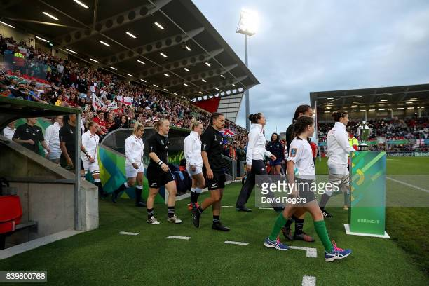 The two teams walk out ahead of the Women's Rugby World Cup 2017 Final between England and New Zealand on August 26 2017 in Belfast United Kingdom
