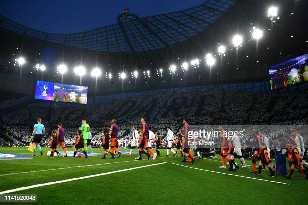 The two teams walk out prior to the UEFA Champions League Quarter Final first leg match between Tottenham Hotspur and Manchester City at Tottenham...