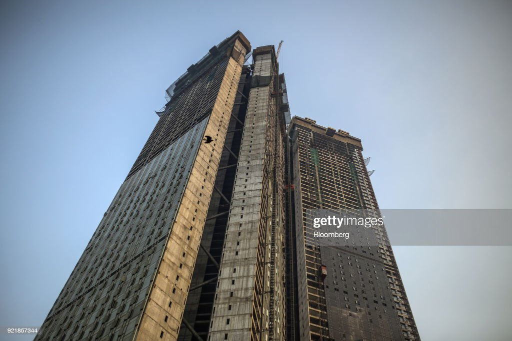The two towers of Trump Tower Mumbai stand under construction at Lodha The Park, a luxury residential project developed by Lodha Developers Ltd., in Mumbai, India, on Tuesday, Feb. 20, 2018. India has the most construction projects with Trump licensing deals of any country outside of the U.S. Photographer: Dhiraj Singh/Bloomberg via Getty Images