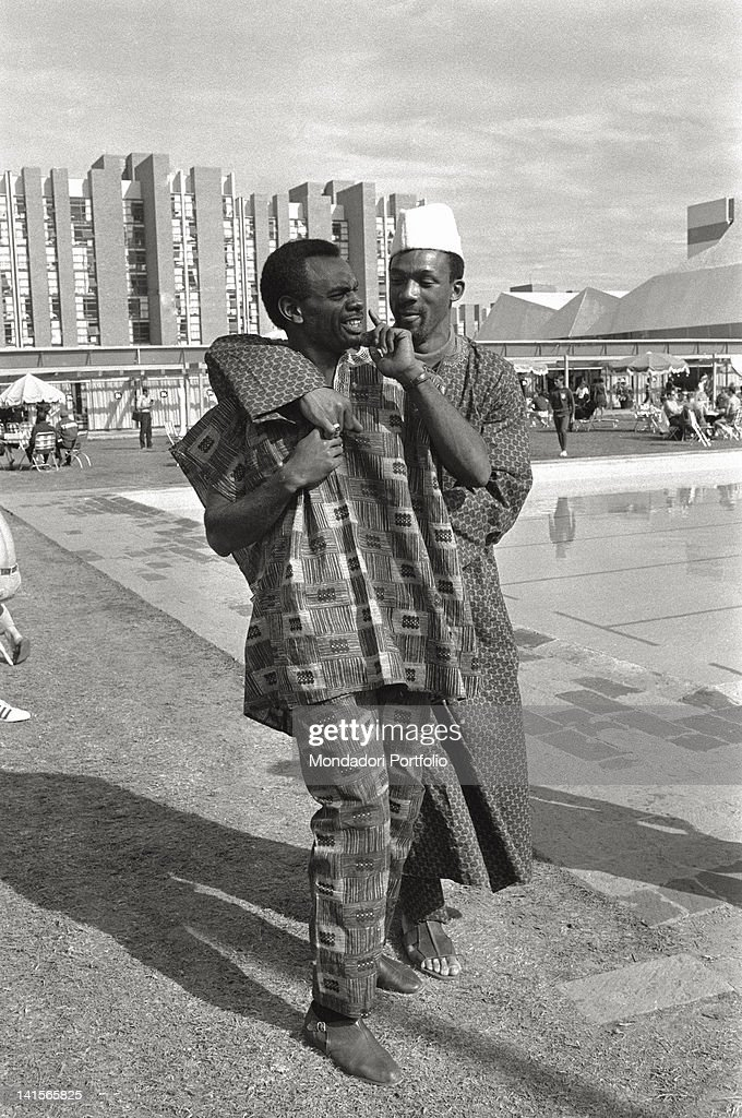 The two US sprinters of the athletic team, Tommie Smith and John Carlos, are joking in the Olympic Village of Mexico City, not far from the outdoor swimming pool. Mexico City (Mexico), October 1968.
