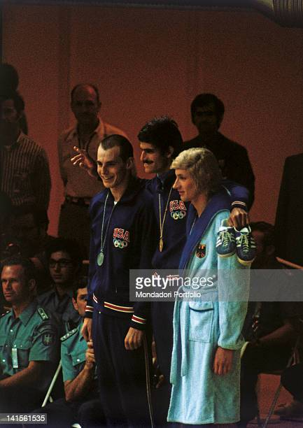 The two US swimmers Mark Spitz and Steve Genter and the German Werner Lampe pose for the official photos after having received the medals of the 200...