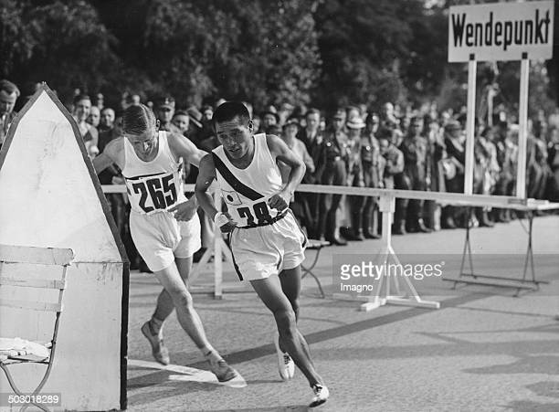 The two winners in the marathon Son Kitei and Ernie Harper at the 1936 Olympic Games in Berlin Turning point on the AVUS 9th August 1936 Photograph
