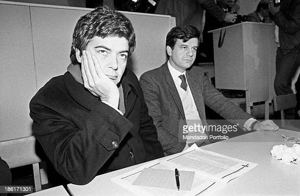 The two young deputy secretaries of the Italian Socialist Party Claudio Martelli and Valdo Spini sit on their desk as guests at the XVI Congress of...