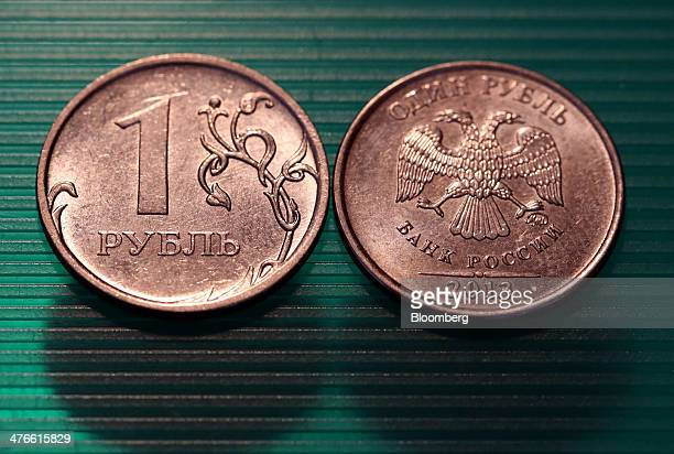 The twoheaded eagle symbol of Russia's central bank sits on a one Russian ruble coin in this arranged photograph in Moscow Russia on Tuesday March 4...
