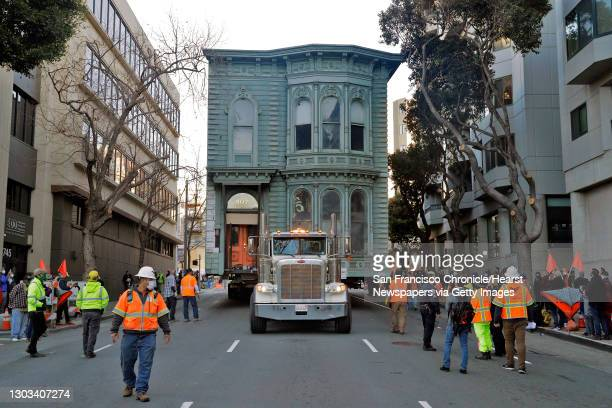 The two-story Englander House Victorian home is pulled down Franklin Street as it was relocated from 807 Franklin Street to 635 Fulton Street in San...