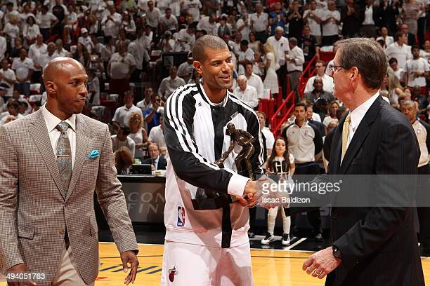 The TwymanStokes Award is given to Shane Battier of the Miami Heat by Chauncey Billups before Game Three of the Eastern Conference Finals against the...