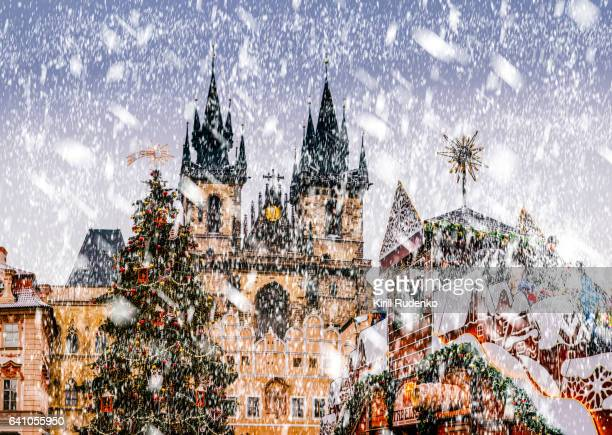 The Tyn Church in Prague and Christmas Tree in winter