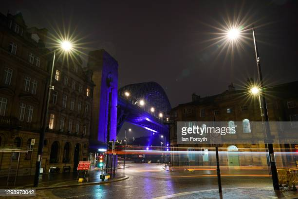 The Tyne Bridge in Newcastle is bathed in purple light to commemorate Holocaust Memorial Day on January 27, 2021 in Newcastle upon Tyne, England....