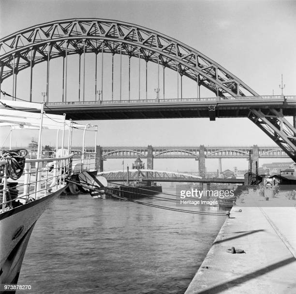 The Tyne Bridges Newcastle upon Tyne 1955 A view from Newcastle quayside of the Tyne Bridge opened in 1928 by King George V In the distance the Swing...