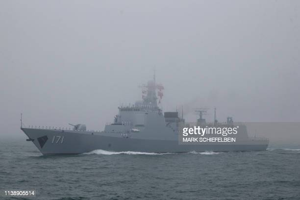 The type 052C destroyer Haikou of the Chinese People's Liberation Army Navy participates in a naval parade to commemorate the 70th anniversary of the...