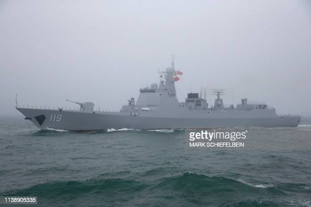 The type 052D guided missile destroyer Guiyang of the Chinese People's Liberation Army Navy participates in a naval parade to commemorate the 70th...