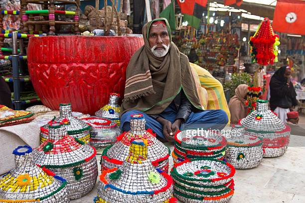 CONTENT] The typical colorful handmade household stuff are put on sale at a street of Bhit Shah where the number of devotees visit and buy these...