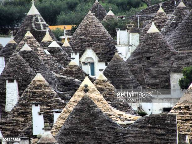 the typical conical stone roofs of trulli houses - alberobello stock pictures, royalty-free photos & images