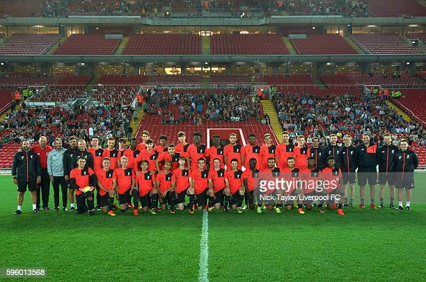 The U18 players pose for a team photo at the end of their training session at Anfield with the new Main Stand in the background on August 26 2016 in...