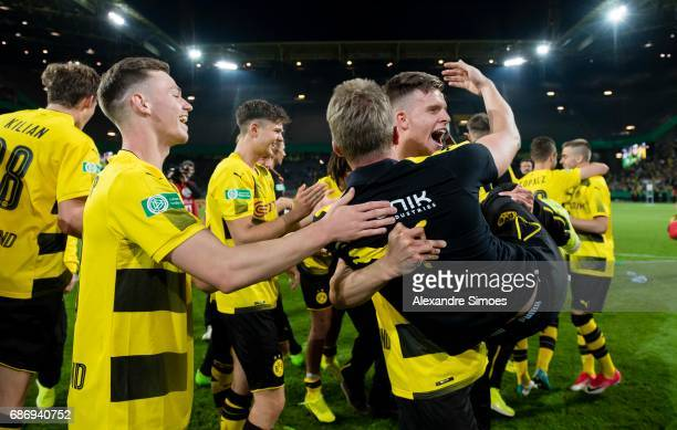The U19 team of Borussia Dortmund celebrates the Championship win with their head coach Benjamin Hoffmann after the final whistle during the U19...