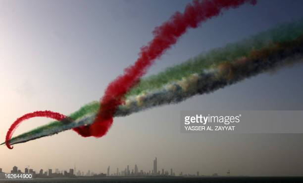 The UAE Hawks the aerobatic team of the United Arab Emirates forces perform during a military show in Kuwait City on February 25 as the Gulf state...